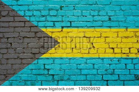Flag of Bahamas painted on brick wall background texture