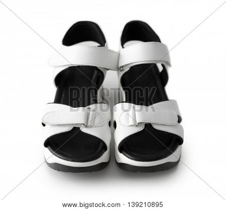 nice white children sandals with black inside isolated on white background