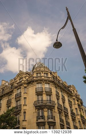 real estate, ancient stone building in Paris, France.