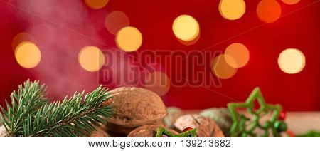 Detail of christmas tree with walnut on the table