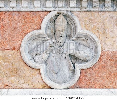 BOLOGNA, ITALY - JUNE 04: Saint Nicholas relief on facade of the San Petronio Basilica in Bologna, Italy, on June 04, 2015