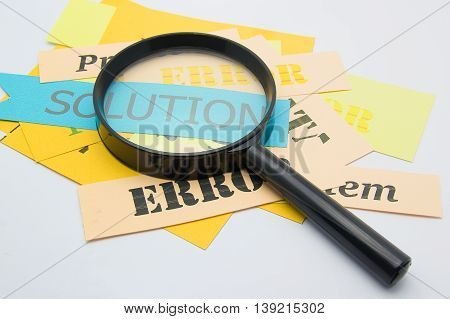 Magnifier on paper focus to solution word