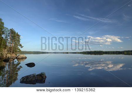 Beautiful Cloudscape With Reflections On Faangsjoen In Sweden