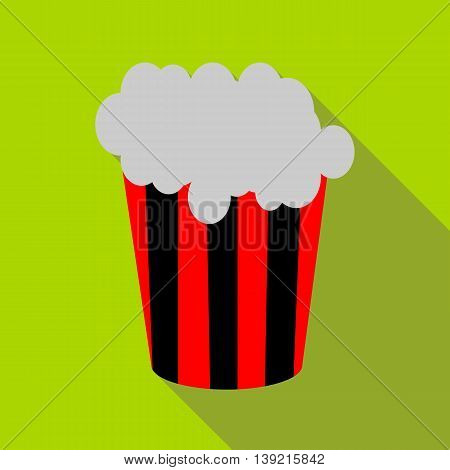 Popcorn in striped bucket icon in flat style on a green background