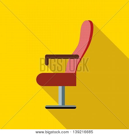 Red cinema armchair icon in flat style on a yellow background