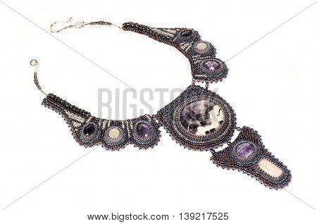 violet beaded necklace with stones, handmade isolated on white background