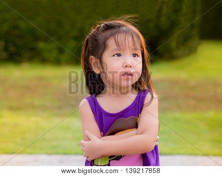 portrait of Asain little cute girl, sad