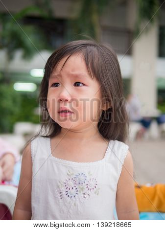 Portrait of a cute little girl crying action