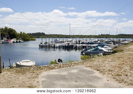 small port in a lake full of boats in summer in France