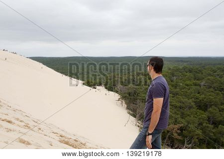 guy looking people going down the Pilat dune in France