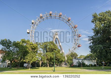 VIENNA, AUSTRIA, JULY 2,2016: Wide angle shot of Wiener Riesenrad, a tall Ferris wheel at the entrance of the Prater amusement park in Leopoldstadt, the 2nd district of Austria's capital Vienna.