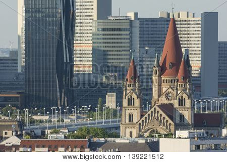 VIENNA, AUSTRIA, JULY 1,2016: Exterior shot of St. Francis of Assisi Church and high rise buildings in the outer district of Vienna, Austria.