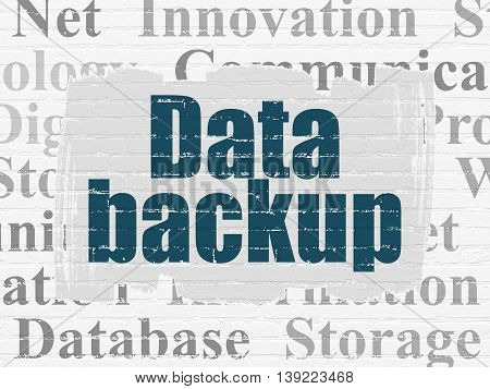 Information concept: Painted blue text Data Backup on White Brick wall background with  Tag Cloud
