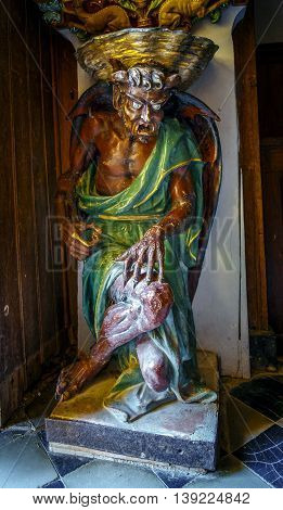Rennes Le Chateau France - July 17 2016: Church of Saint Mary Magdalene famous demon at the entrance of the door - Rennes le Chateau - France