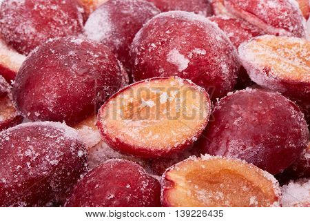 Background of fresh frozen red plums