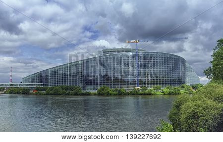 STRASBOURG, FRANCE - JUNE 19, 2016: back of European Parliament, Louise Weiss building, 1999 in Wacken district of Strasbourg and Ill river