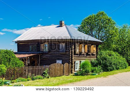Russian farmstead in village in summer day. Countryside