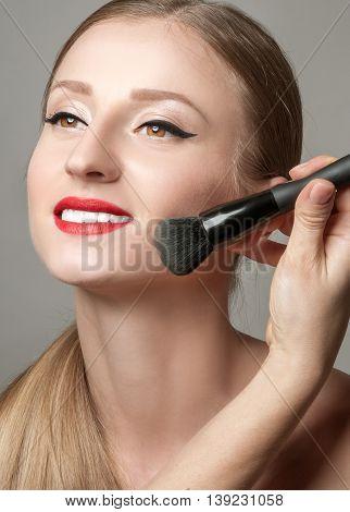 Makeup. Make-up closeup. Cosmetic Powder Brush. Perfect Skin