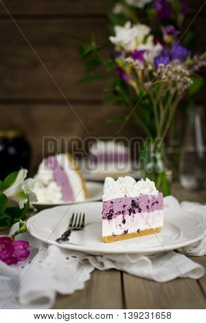 A piece of layered blueberry no-bake cheesecake