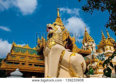 Entrance With Huge Statues Of Animals. Shwedagon Paya Pagoda. Yangon, Myanmar