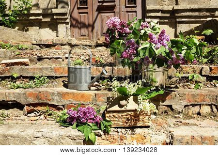 Bouquets of spring flowers on doorsteps