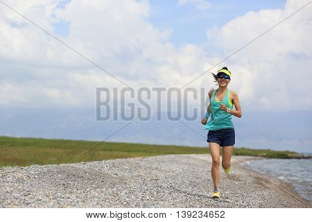 fitness young woman trail runner running on beautiful trail