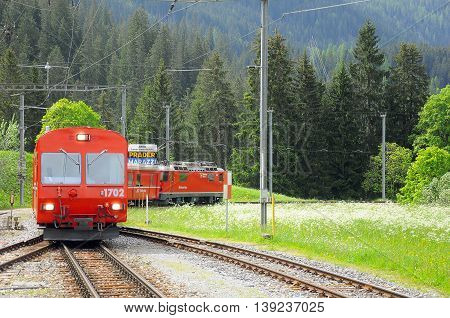 Langwies Switzerland - June 07 2010: Passenger train from Arosa to Chur approach to the station platform.