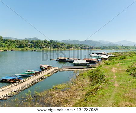 Boats on local made bamboo float Kanchanaburi Thailand