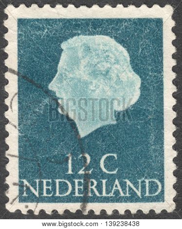 MOSCOW RUSSIA - CIRCA JANUARY 2016: a post stamp printed in NETHERLANDS shows a portrait of Queen Juliana the series