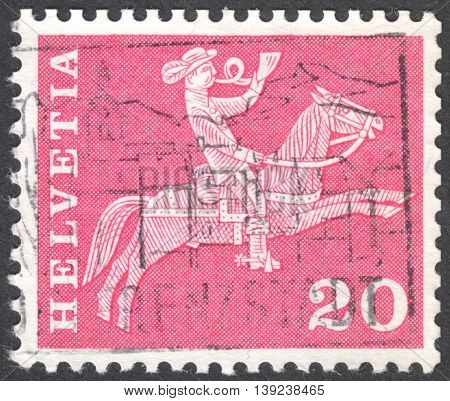 MOSCOW RUSSIA - CIRCA JANUARY 2016: a post stamp printed in SWITZERLAND shows the 19th century mounted postman the series