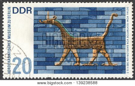 MOSCOW RUSSIA - CIRCA JANUARY 2016: a stamp printed in DDR shows details of mythological animals from Ishtar gate Babylon 580 B.C. Pergamon museum Berlin the series