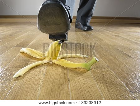 Business risk concept: Man to step on banana skin.