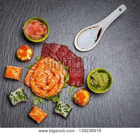 Beautiful sushi arrangement on stone slate