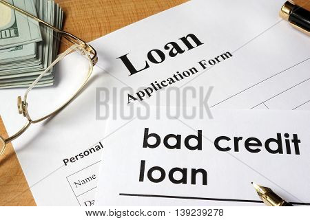 Page of Bad credit loan and application form on a table.