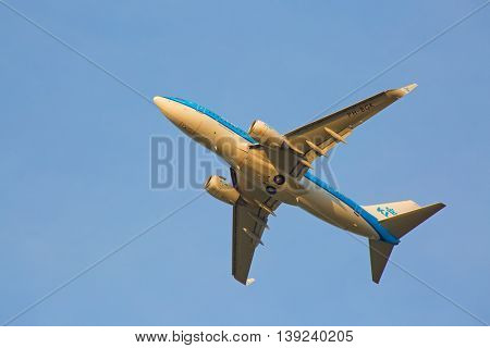 ZURICH - JULY 18: Boeing-737 KLM taking off at sunset from Zurich after short haul flight on July 18, 2015 in Zurich, Switzerland. Zurich airport is one of biggest european hubs.