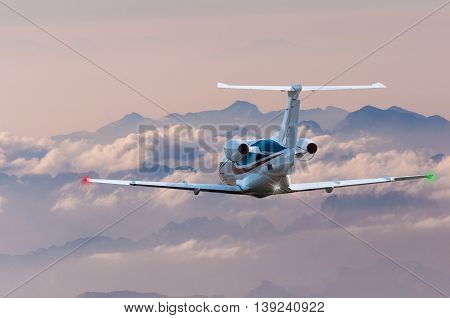 Privat plane or aircraft flight surrounded by mountains and rocks.