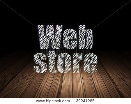 Web development concept: Glowing text Web Store in grunge dark room with Wooden Floor, black background