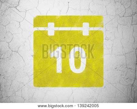 Timeline concept: Yellow Calendar on textured concrete wall background