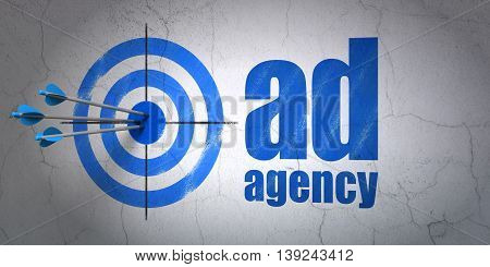 Success advertising concept: arrows hitting the center of target, Blue Ad Agency on wall background, 3D rendering