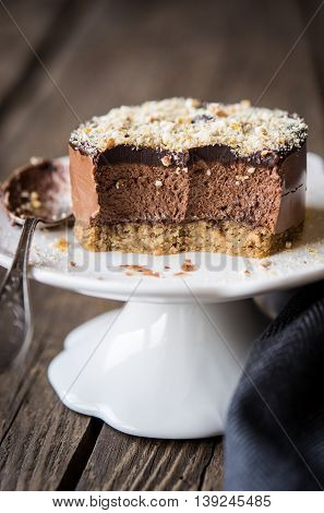Chestnut and chocolate mini cake on a cake stand