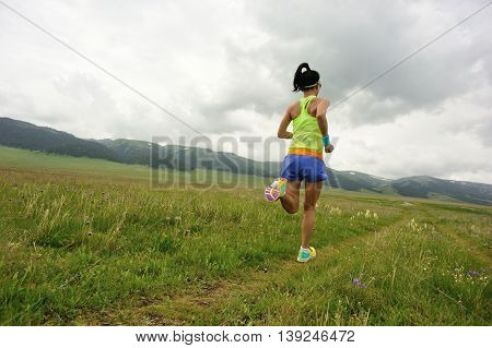 healthy lifestyle young woman runner running on beautiful road