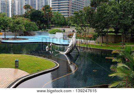 Kuala Lumpur/Malaysia - September 2012: Park near the Petronas Twin Towers in Kuala Lumpur Malaysia