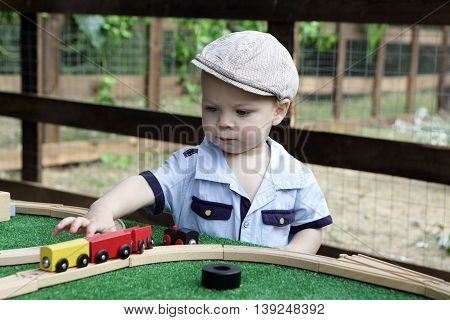 Toddler Playing With Toy Railroad