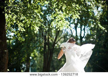Gorgeous Bride Posed On Sunshine Park