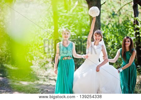 Cute Bride With Two Bridesmaids On Velvet Green Dress
