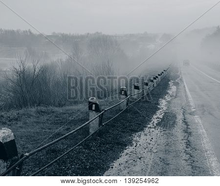 old road in the countryside in the fog