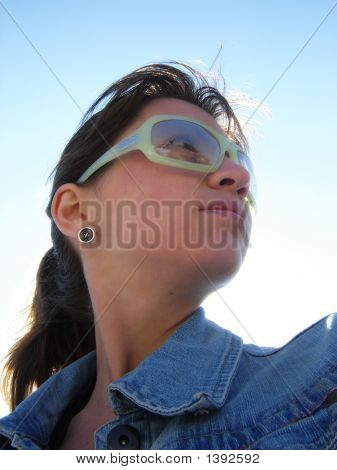 Portrait Of The Young Woman On  Blue Sky