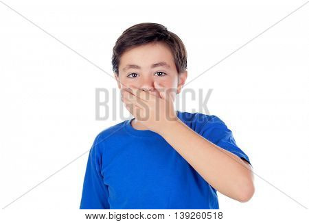 Little boy with ten years old covering his mouth isolated on a white background