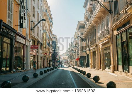 Cannes, France - June 28, 2015: View of city street with parking restrictions balls barriers in Cannes, France
