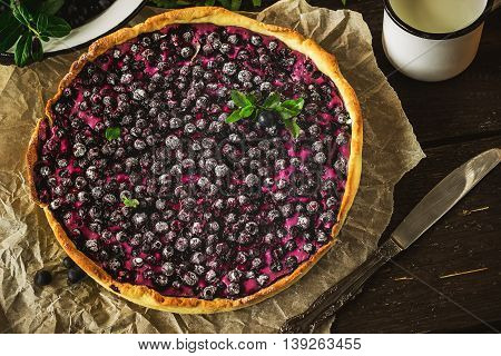 Homemade Pie With Bilberry  On Dark Wooden Table